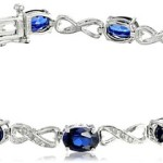 Sterling Silver Infinity Created Blue Sapphire and Diamond Bracelet (1/10 cttw) Just $114.29 w/ Free One Day Shipping!
